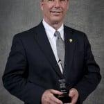 Re/Max broker/owner,Ron Ewing receiving his award