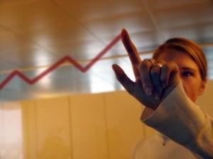 Woman showing sales figures