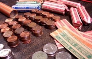 Pennies, quarters, dimes, and nickels in rolls