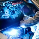 Worker performs key weld in auto plant
