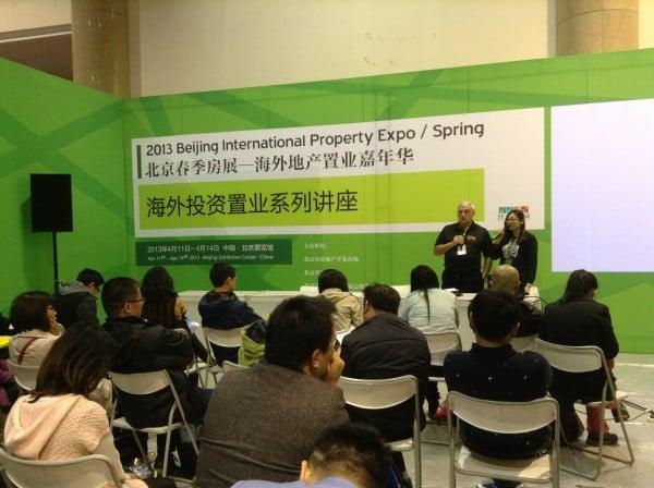 Century 21 Team Feltrim CEO Garrett Kenny alongside  his translator Mina Mu