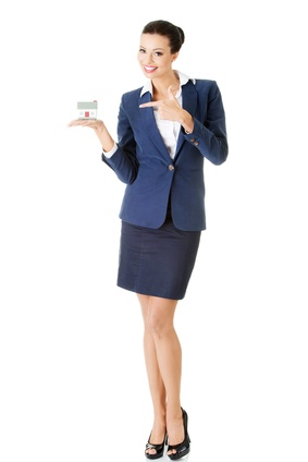 Beautiful young businesswoman holding house model - real estate