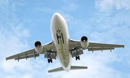 passenger jet aircraft arrriving at an airport