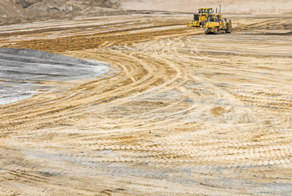 Construction site sandy soil wide open space, tire tracks
