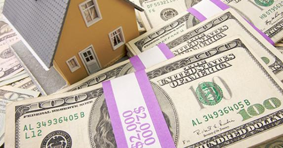 house-with-money-2k-bill-stacks_573x300