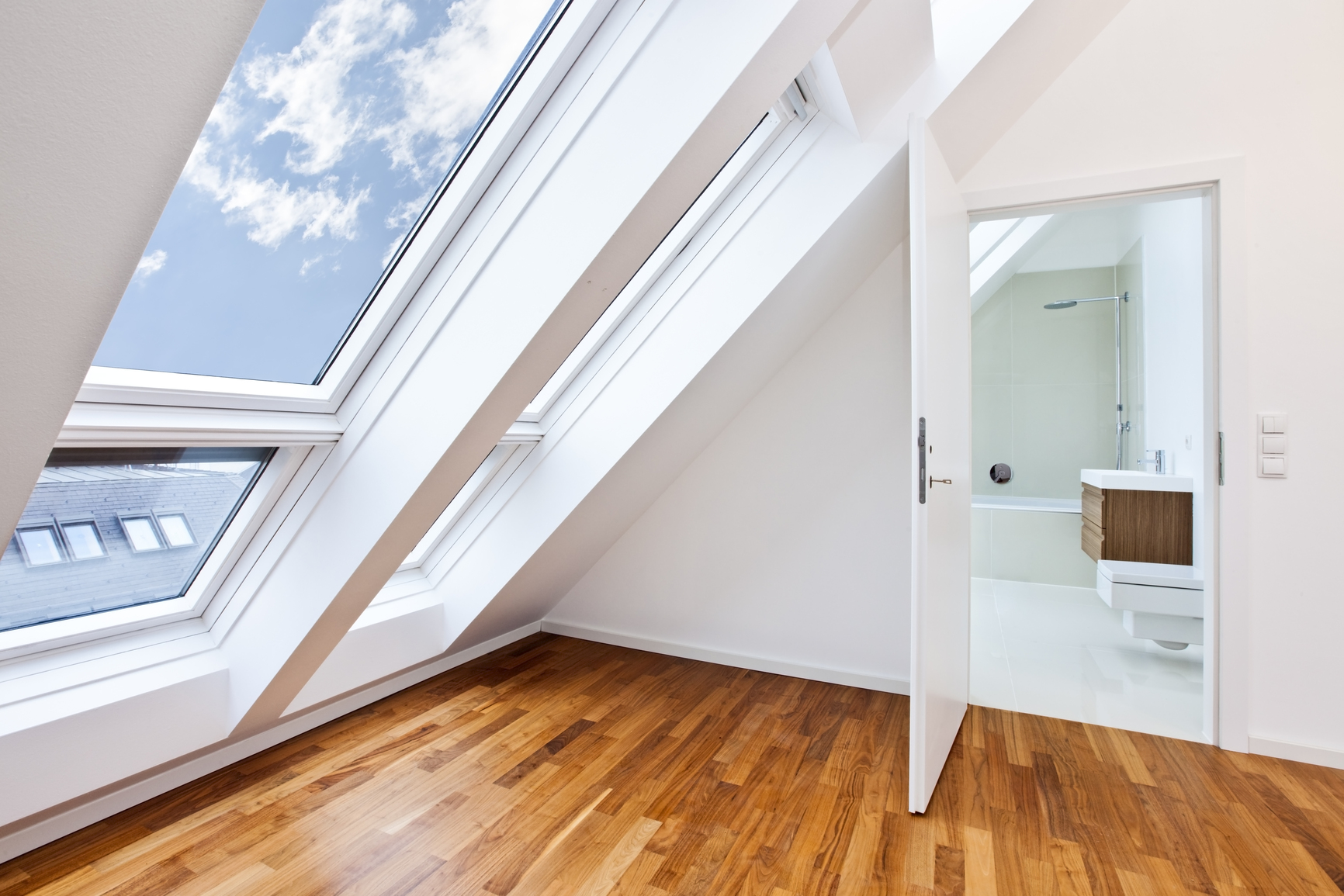 Contemporary apartment with sunlit modern bathroom and look through roof-top-window.