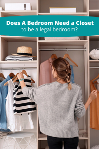 Woman hanging clothes in a closet- Legally does a bedroom have to have a closet?