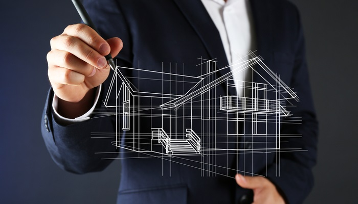 businessman drawing a house model